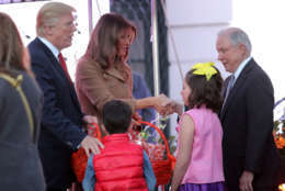 WASHINGTON, DC - OCTOBER 30:  U.S. President Donald Trump (L) and first lady Melania Trump greet Attorney General Jeff Sessions (R) and the children he was accompanying while hosting Halloween at the White House on the South Lawn October 30, 2017 in Washington, DC. The first couple gave cookies away to costumed trick-or-treaters one day before the Halloween holiday.  (Photo by Chip Somodevilla/Getty Images)