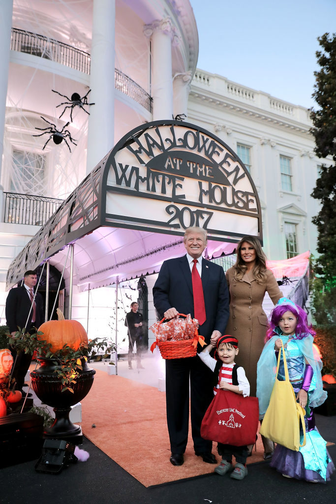 WASHINGTON, DC - OCTOBER 30:  U.S. President Donald Trump (L) and first lady Melania Trump pose for photographs while hosting Halloween at the White House on the South Lawn October 30, 2017 in Washington, DC. The first couple gave cookies away to costumed trick-or-treaters one day before the Halloween holiday.  (Photo by Chip Somodevilla/Getty Images)