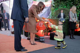 WASHINGTON, DC - OCTOBER 30:  U.S. first lady Melania Trump gives a cookie to little trick-or-treater while hosting Halloween at the White House on the South Lawn October 30, 2017 in Washington, DC. The first couple gave cookies away to costumed trick-or-treaters one day before the Halloween holiday.  (Photo by Chip Somodevilla/Getty Images)