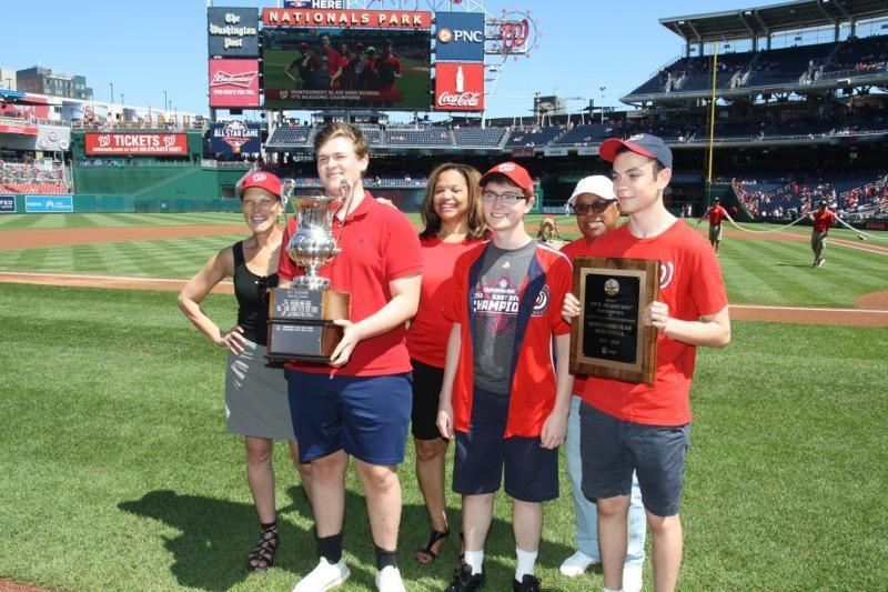 "From left, Hillary Howard, Anson Berns, Montgomer Blair principal Renay Johnson, Ben Miller, Montgomery County school board member Jeannette Dixon and Ian Rackow, attend an event on Sunday, Sept. 3, 2018, honoring the winner of the 57th ""It's Academic"" at Nationals Park. (Courtesy Hillary Howard)"