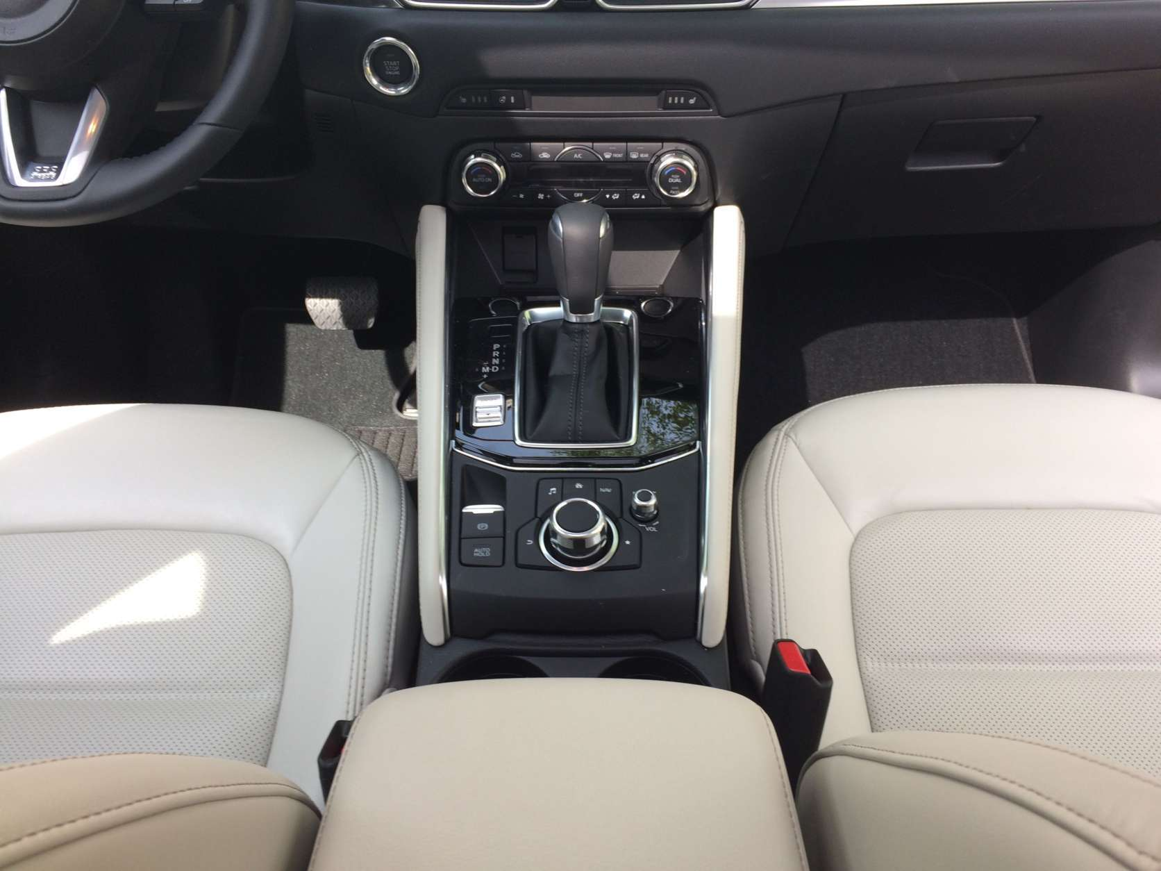 Layouts for radio and NAV controls have changed and are now more luxury-car like with a wheel in the middle of the console to control most functions. Even the volume and radio tuning is done behind the shifter. (WTOP/Mike Parris)