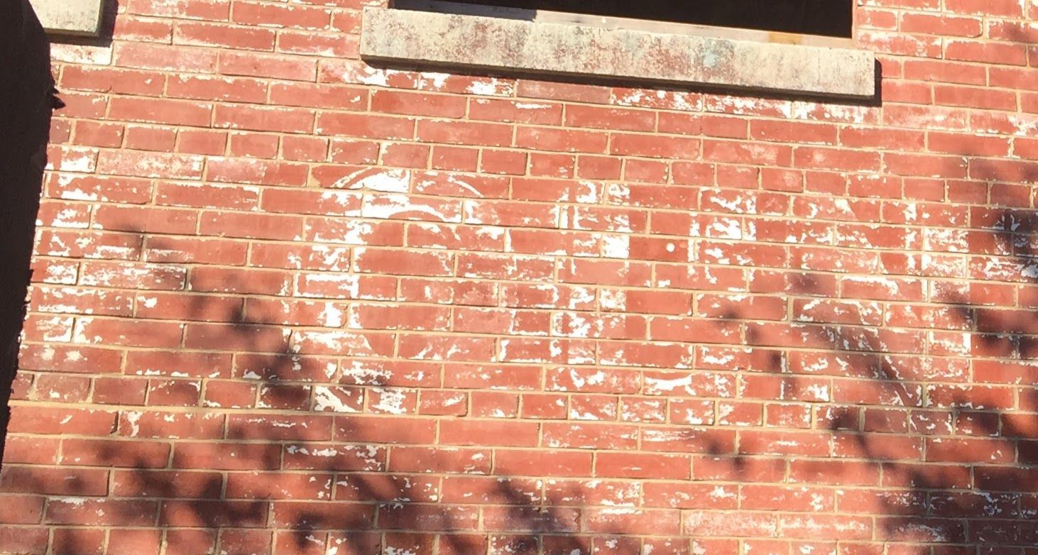 At D.C.'s old Chapman Stable (57 N St. NW), a once-painted-over sign remains. (WTOP/Jack Pointer)