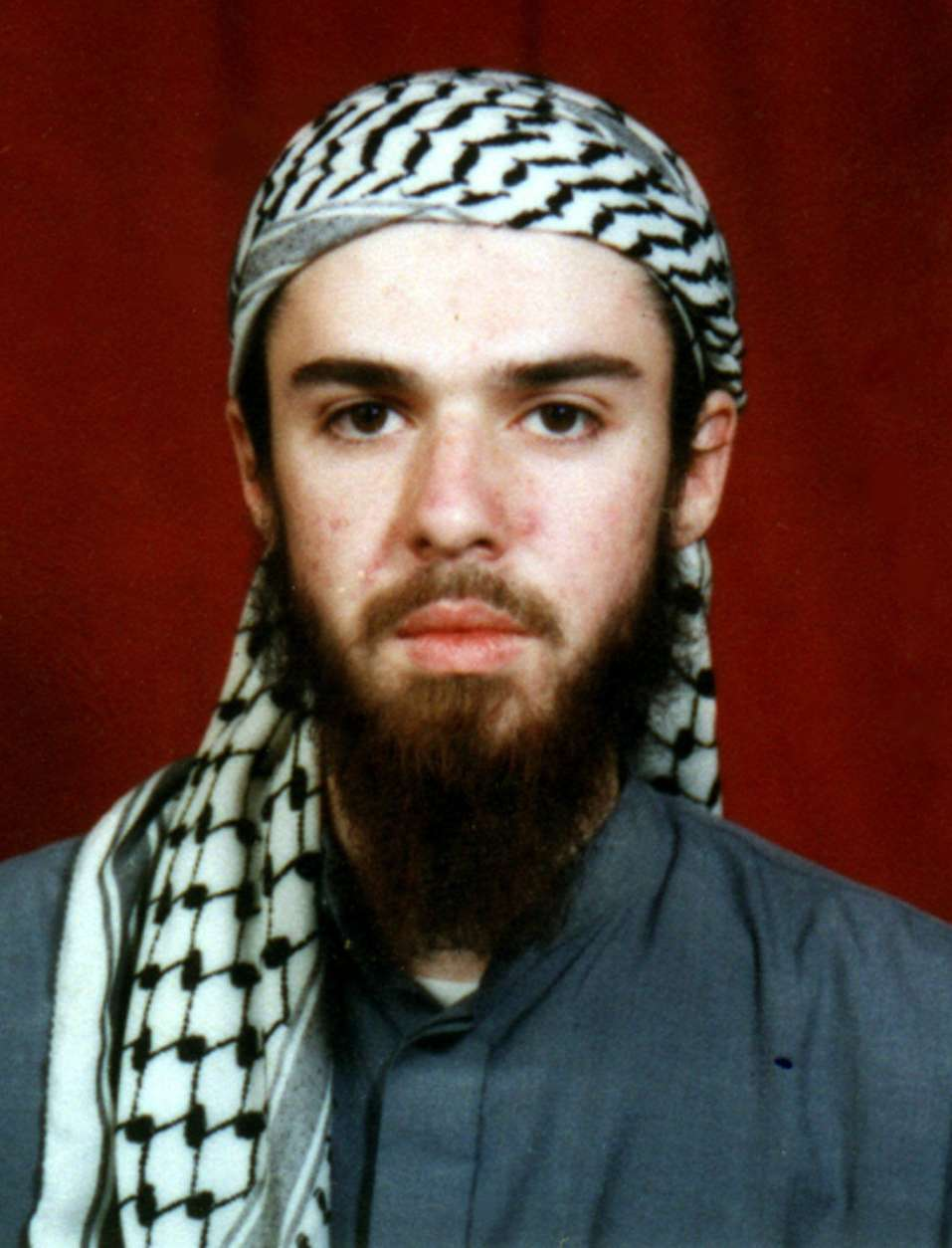 American John Walker Lindh is seen in this undated photo obtained Tuesday, Jan. 22, 2002, from a religious school where he studied for five months in Bannu, 304 kilometers (190 miles) southwest of Islamabad, Pakistan. Lindh, who fought with the Taliban in Afghanistan, began his journey home from the war in Afghanistan on Tuesday to face charges he conspired with Islamic radicals to kill fellow countrymen. (AP Photo)