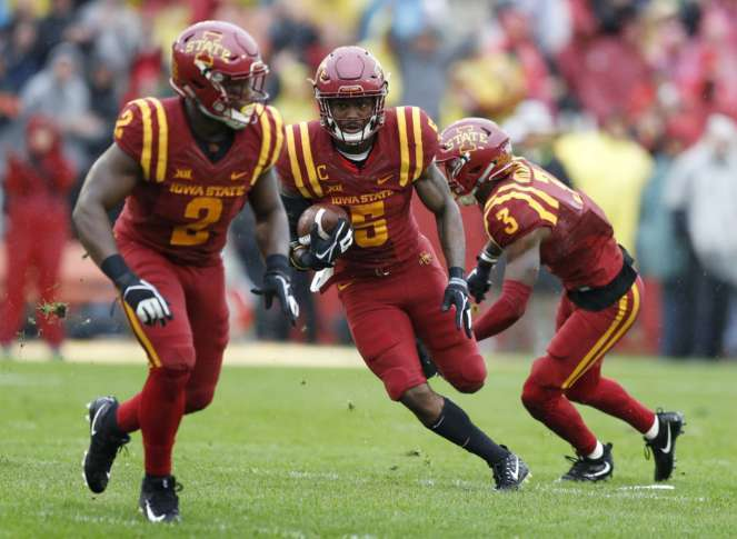 Montgomery scores 3 TDs as Cyclones blank Jayhawks