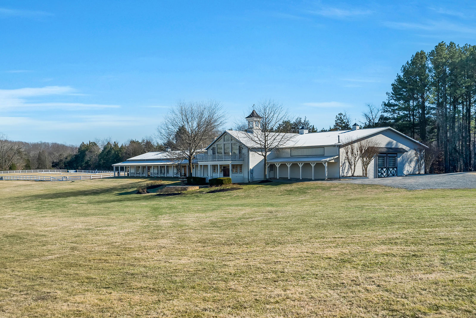 The property also includes an 11,200-square-foot indoor riding arena, two show arenas and stables and offers boarding and training. (Courtesy Auction Markets LLC)
