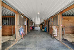 The property also includes an 11,200-square-foot indoor riding arena, two show arenas and stables and offers boarding and training. It also hosts regular events, including seven Virginia Horse Show Association Hunter/Jumper shows booked for 2017, according to the listing. (Courtesy Auction Markets LLC)
