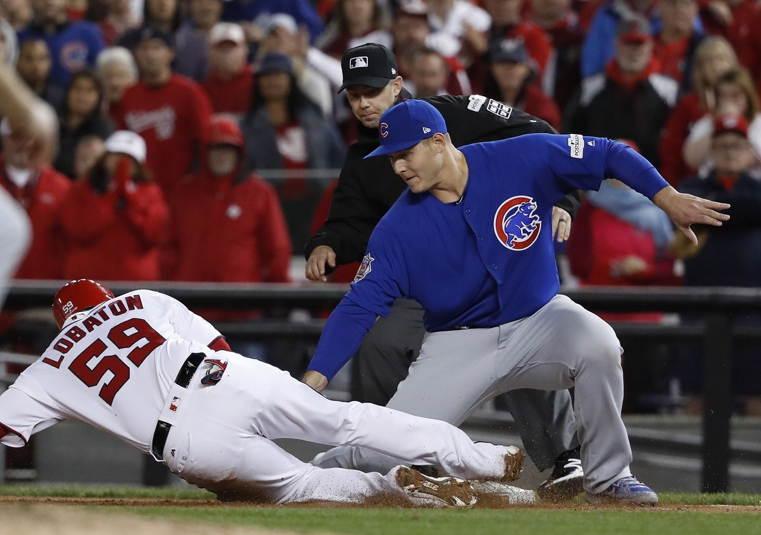 Chicago Cubs first baseman Anthony Rizzo (44) picks off Washington Nationals' Jose Lobaton on a throw from catcher Willson Contreras during the eighth inning in Game 5 of baseball's National League Division Series against the Chicago Cubs, at Nationals Park, early Friday, Oct. 13, 2017, in Washington. The Cubs challenged the call on the field and it was overturned on review. (AP Photo/Pablo Martinez Monsivais)