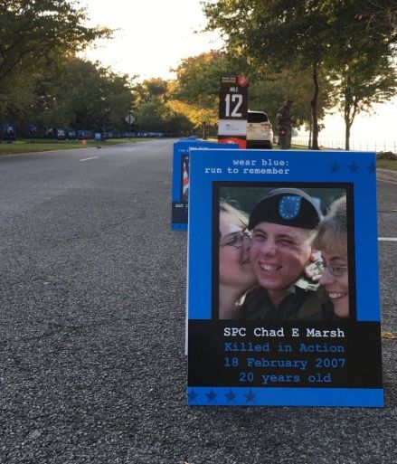 Over 275 service members are remembered in photos along the Potomac River. (WTOP/Monique Blyther)