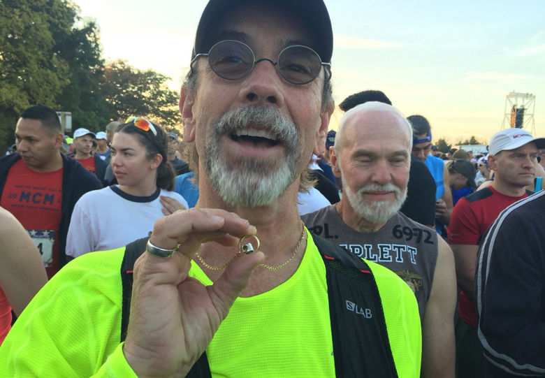 Peter Dernier shows the ring he will give his wife 17 years after proposing to her at a Marine Corps Marathon. (WTOP/John Domen)