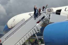 Vice President Mike Pence, joined by his wife Karen Pence and Virgin Islands Del. Stacey Plaskett, D-At Large, wave after landing at Henry E. Rohlsen Airport in Frederiksted, U.S. Virgin Islands, Friday, Oct. 6, 2017.  (AP Photo/Ken Thomas)