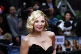 "FILE - In this May 27, 2010, file photo, Kim Cattrall poses for the photographers as she arrives for the British premiere of the film ""Sex and the City 2"" in London. Cattrall says the demanding production schedule of the franchise during its run as an HBO series played a part in her decision not to have children. (AP Photo/Lefteris Pitarakis, File)"