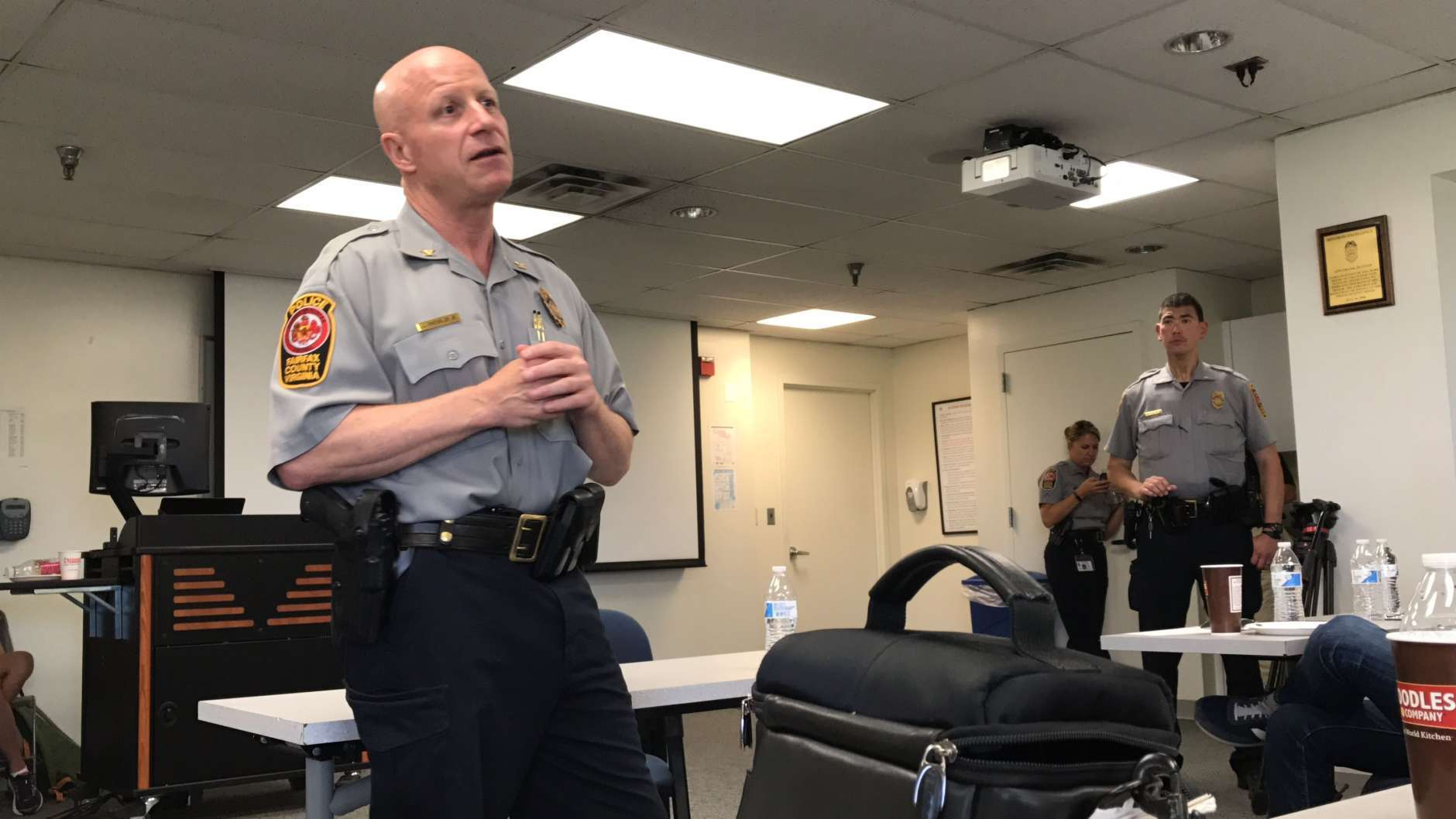 Fairfax County Police Chief Ed Roessler talks to members of the media who are trying to learn about the every day dangers law enforcement officers face. (WTOP/Ginger Whitaker)