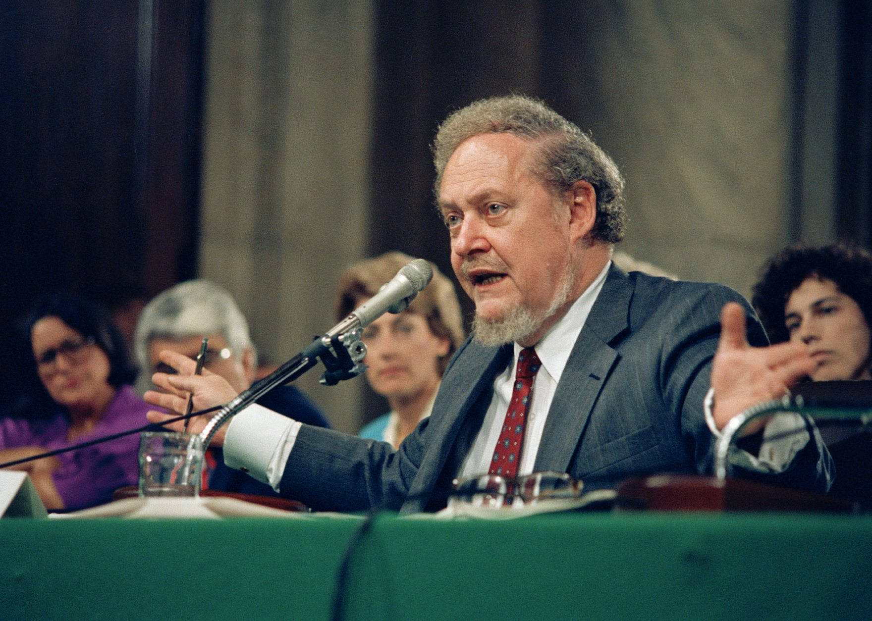 Supreme Court Justice nominee Robert H. Bork gestures as he testifies on Capitol Hill, before the Senate Judiciary Committee holding his confirmation hearings, Sept. 16, 1987. Bork denied that he acted illegally in firing special Watergate prosecutor Archibald Cox 14 years ago. (AP Photo/John Duricka)