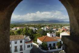 In this Wednesday, Oct. 4, 2017 photo, both Catalan and Spanish sides are seen from the church tower at San Rafael del Rio, a small regional border-town some 207 kilometers (129 miles) south of Barcelona. Spain. The river that runs through San Rafael del Rio, a quiet rural town with a population of just over 500, provides a natural boundary between the Spanish regions of Catalonia and Valencia. Now residents are worried that the escalating conflict between Spanish and Catalan authorities will split the town in two. (AP Photo/Mstyslav Chernov)