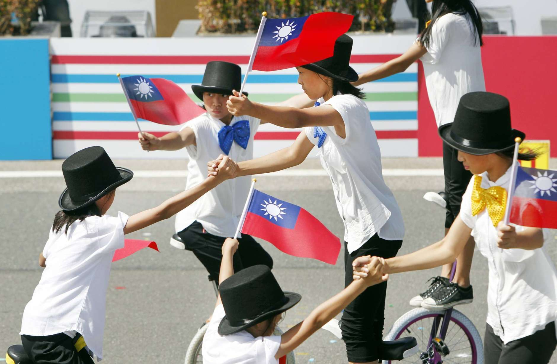 Performers show their skills during the National Day celebrations in Taipei, Taiwan, Tuesday, Oct. 10, 2017. Taiwan's independence-leaning government will defend the self-governing island's freedoms and democratic system amid heightened tensions with rival China, President Tsai Ing-wen said Tuesday. (AP Photo/Chiang Ying-ying)