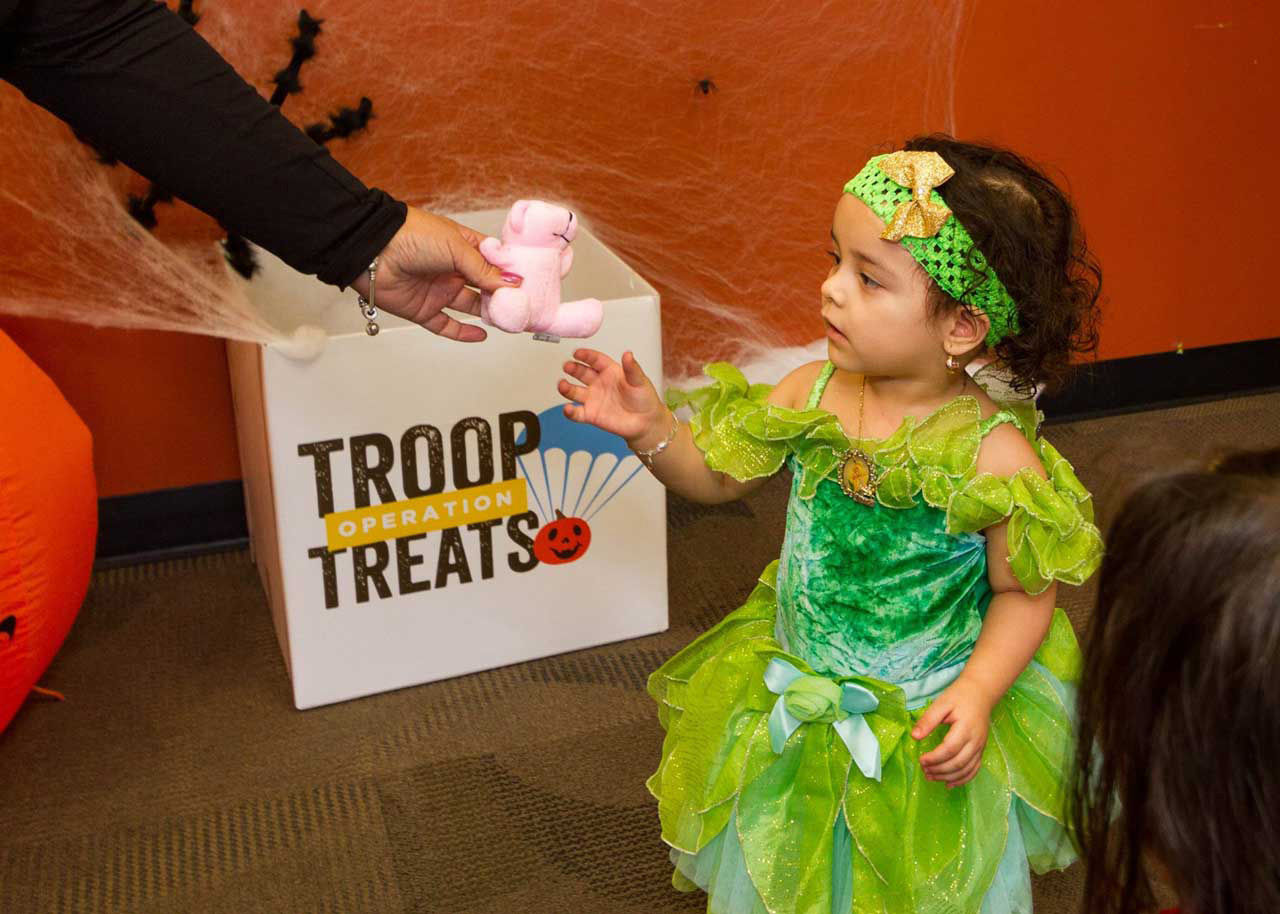 Children get a toy in exchange for 25 pieces of unwanted candy, but there is a three toy limit for kids. (Courtesy Operation Troop Treats)