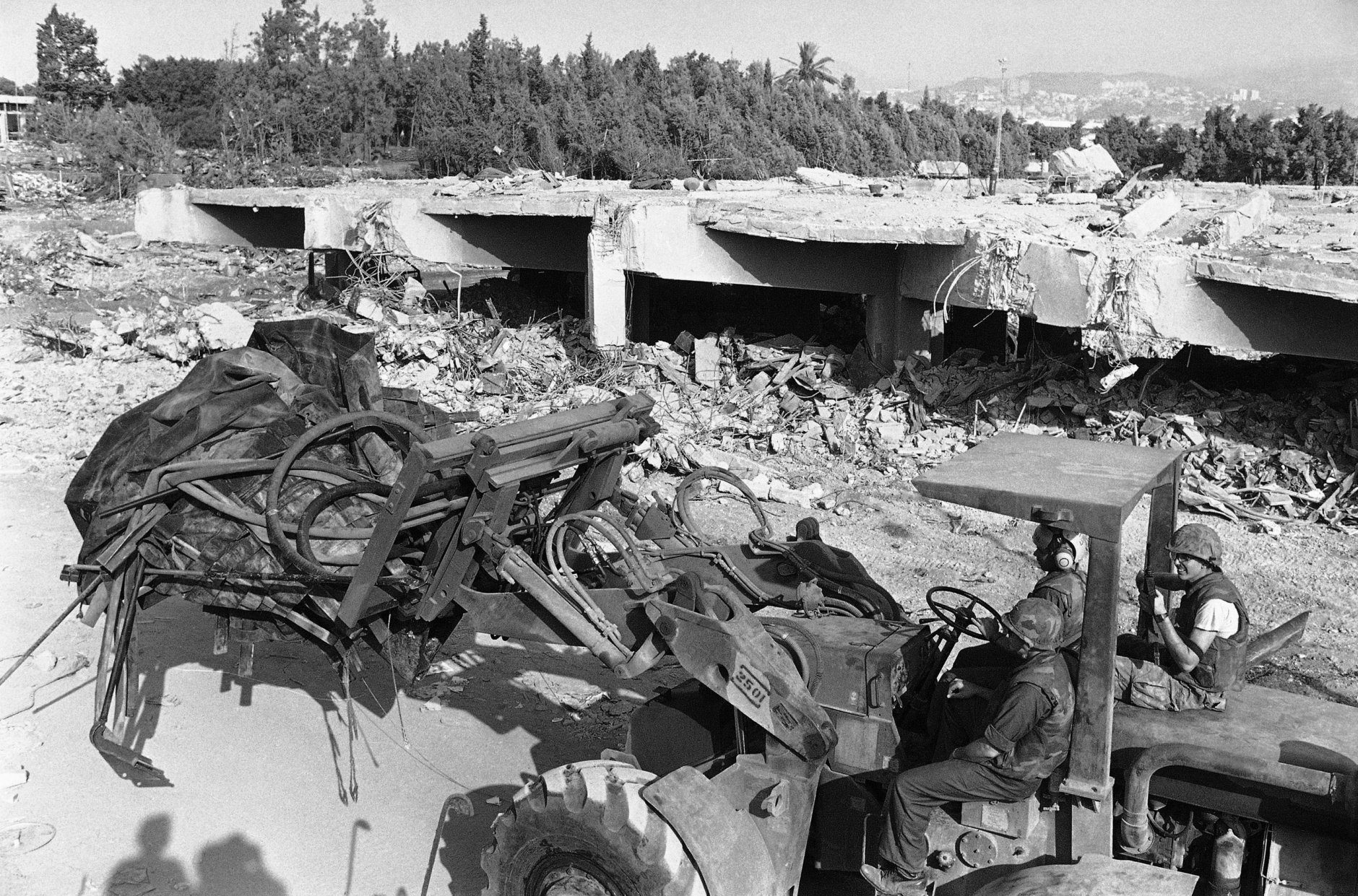 A bulldozer manned by U.S. Marines is shown at Beirut's International Airport, Oct. 30, 1983.  Work and the recovery of more bodies continues following last Sunday's terrorist attack in Lebanon where the death toll has now reached 230 according to a U.S. Army spokesman.  (AP Photo/Bill Foley)