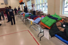 Nearly 500 brand-new jackets are being given away to needy families in Alexandria as part of Operation Warm and Firefighter Coats for Kids. (WTOP/John Domen)