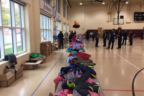 Alexandria city first responders hand out new coats to kids for free