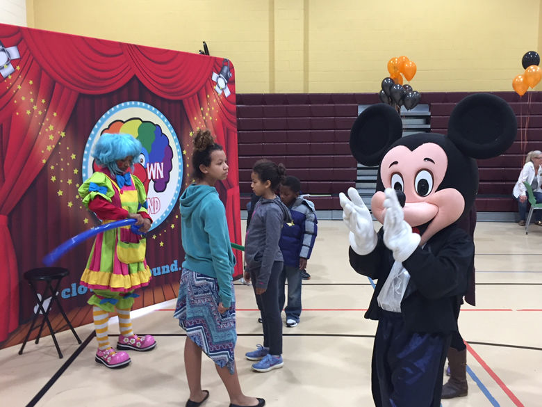 The event also featured face painting, balloons, a book giveaway and a dancing Mickey Mouse. (WTOP/John Domen)
