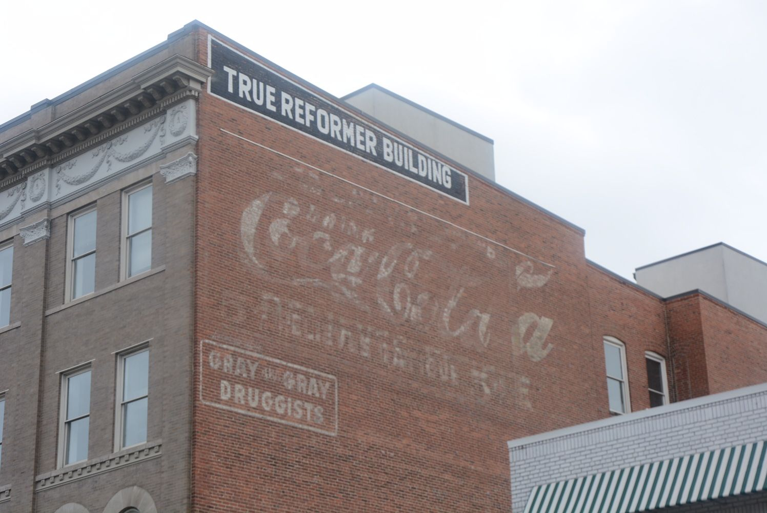 At the True Reformer Building (1200 U St. NW), a Coca-Cola sign has endured the years. (WTOP/Dave Dildine)