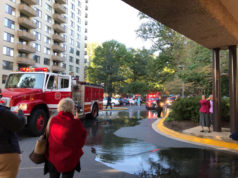 Firefighters helped residents evacuate due to the amount of smoke. (WTOP/Bruce Alan)