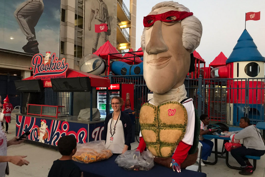 The Washington Nationals' Racing President mascot George Washington dresses as a Teenage Mutant Ninja Turtle during a Halloween-themed game, Oct. 4, 2017 at Nationals Park. (WTOP/Michelle Basch)