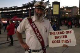 "A baseball fan is dressed as Hotels.com's spokesman Captain Obvious during a ""Haunted Pep Rally"" at Nationals Park, Oct. 4, 2017. (WTOP/Michelle Basch)"