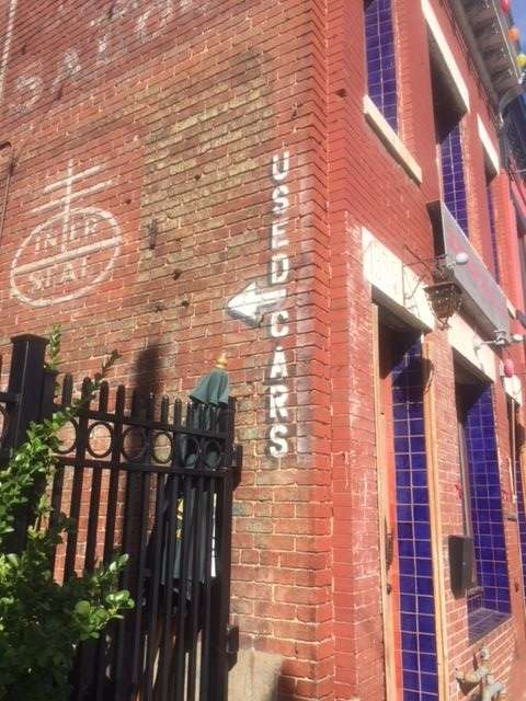 The Uneeda Biscuit ghost sign at 1358 H St. NE shares a wall with another unrelated ghost sign. (WTOP/Jack Pointer)