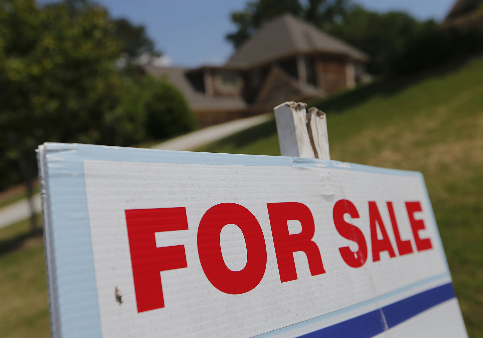Homes in D.C. sold quickly but monthly data from Long & Foster Real Estate Inc. shows overall closed sales in the District were down 16 percent from September 2016. (AP/John Bazemore)