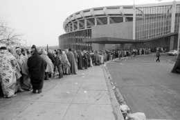Washington Redskins fans stand in line towards RFK Memorial Stadium in Washington waiting to purchase tickets for next Saturday's NFC championship game against the winner of Sunday's Green Bay-Dallas game, Jan. 16, 1983. The fans started gathering around the stadium late Saturday night after the Redskins defeated the Minnesota Vikings 21-7 to advance to the championship game of the National Conference. (AP Photo/Ira Schwarz)