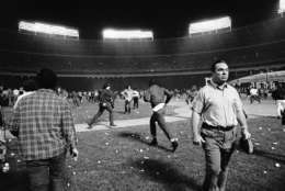 Washington Senators fans storm the field, stopping the game in the ninth inning, between the Yankees and the Senators, in Washington, Oct. 1, 1971. Fans' actions caused the Senators to forfeit the game to the Yankees. (AP Photo/Jim Palmer)