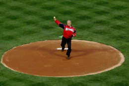 President Bush throws out the ceremonial first pitch at RFK Stadium Thursday, April 14, 2005 in Washington. Tonight's game between the Washington Nationals and the Arizona Diamondbacks is the first regular-season baseball game in the nation's capital in 34 years.  (AP Photo/Pablo Martinez Monsivais)