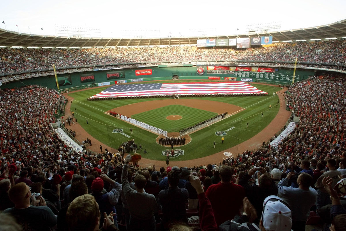 Fans cheer during the opening day ceremonies at RFK Stadium between the Washington Nationals and the Arizona Diamondbacks Thursday, April 14, 2005 in Washington. Thursday's game is the first regular-season baseball game in the nation's capital in 34 years.  (AP Photo/Pablo Martinez Monsivais)