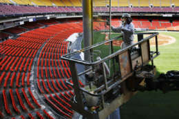 Daniel Lepe, paints a foul pole at RFK Stadium, the home field of the Washington Nationals, Tuesday, March 29, 2005, in Washington. Excitement is building for the Washington Nationals Opening Day match-up against the Philadelphia Phillies in Philadelphia next week, but fans in the DC area may not be able to see it on television. (AP Photo/Manuel Balce Ceneta)