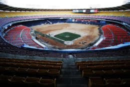 The Washington Nationals' home field, the RFK Memorial Stadium, is seen from the upper bleachers behind the home plate, as workers lay the turf, Monday, March 14, 2005, in Washington. The playing field will have 111,000 square feet of sand-based hybrid Bermuda grass over-seeded with perennial rye grass. (AP Photo/Manuel Balce Ceneta)