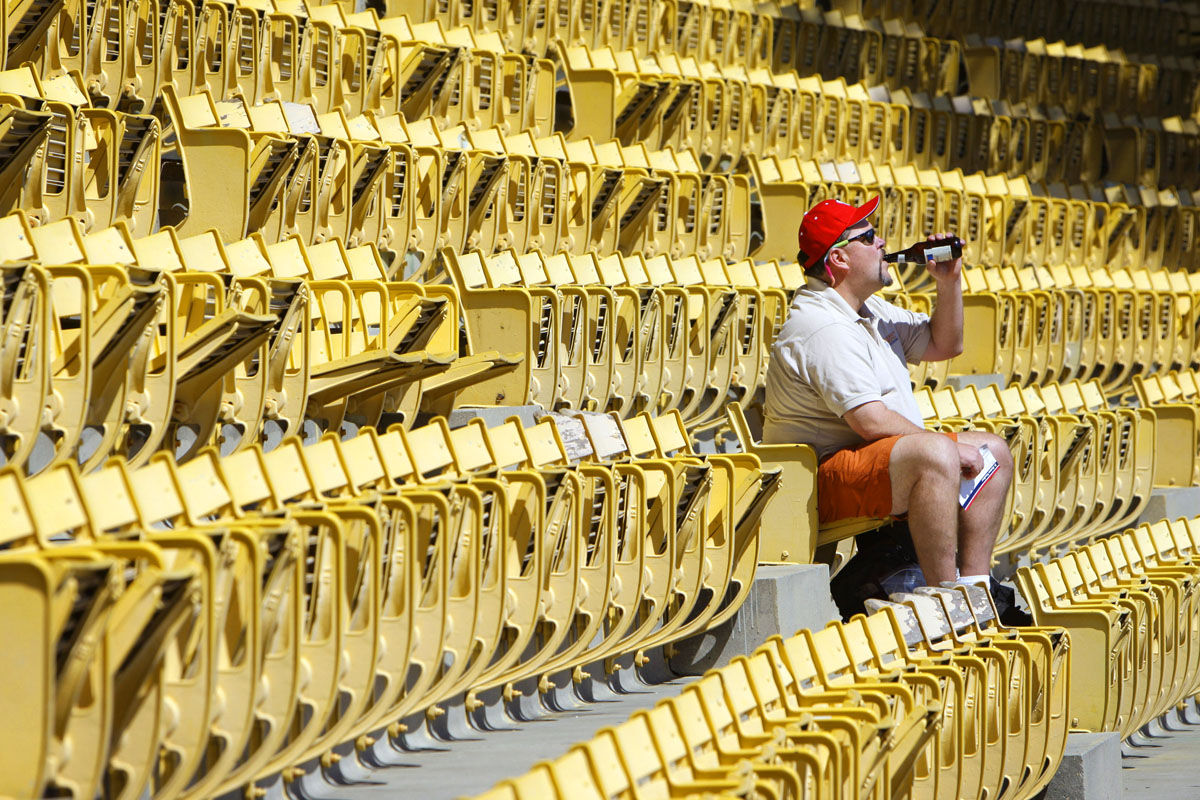Carl G. Evans, from Warrenton, Va., drinks his beer as he sits in the upper deck section of RFK Stadium before the start of the baseball game between the Atlanta Braves and the Washington Nationals, Sunday Sept. 16, 2007 at RFK Stadium in Washington. The Washington Nationals are entering their final home stand at RFK Stadium, which opened in 1962 in the nation's capital. The stadium has also been home to the Washington Senators, the NFL's Washington Redskins, and the MLS DC United Soccer team. The Nationals are moving to a new $611 million ballpark, located in Southeastern Washington along the Anacostia River for opening day in April, 2008. (AP Photo/Pablo Martinez Monsivais)