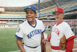 Willie Mays, formally of the San Francisco Giants and New York Mets, left, clowns around with Luke Appling, formally with the Chicago White Sox, before the Old Timers Baseball Classic at R.F.K. Stadium on Monday, June 23, 1986 in Washington.   Twenty-one National Leaguers will face 26 from the American League in the 30th anniversary of this All-Star game. (AP Photo/J. Scott Applewhite)