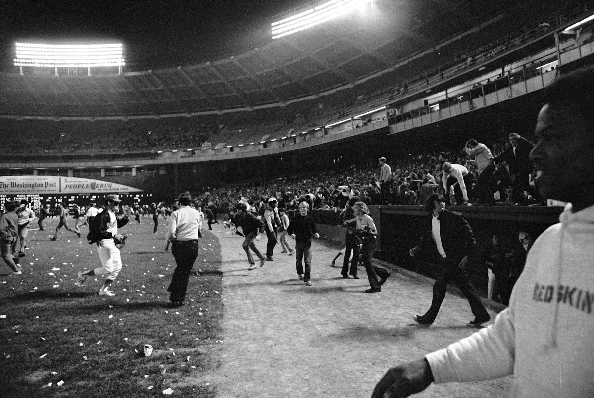 Washington Senators fans storm the field, stopping the game in the ninth inning, between the Yankees and the Senator, in Washington, Oct. 1, 1971. Fans' actions caused the Senators to forfeit the game to the Yankees. (AP Photo/Jim Palmer)