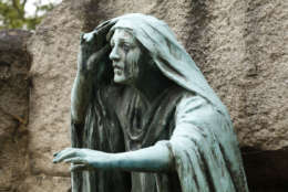 """Rock Creek Cemetery is the site of some """"master sculptures,"""" said Anne Brockett, an archictectural historian in the D.C. Office of Historic Preservation. This sculpture called Rabboni depicts the moment Mary Magdalene emerged from Jesus' tomb to discover he had arisen. The sculpture was designed by artist Gutzon Borglum for a prominent D.C. banker. Borglum also famously designed Mount Rushmore.  (WTOP/Kate Ryan)"""