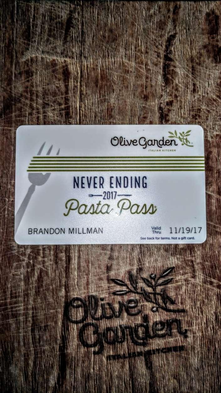 WTOP's Brandon Millman receives his Never Ending Pasta Pass from Olive Garden. (WTOP/Brandon Millman)