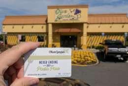 WTOP's Brandon Millman flashes his Pasta Pass outside the Falls Church Olive Garden. (WTOP/Brandon Millman)