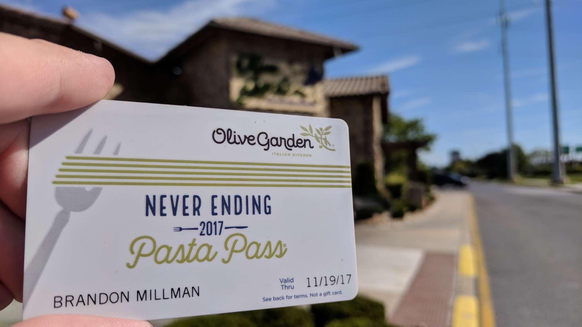 WTOP's Brandon Millman brandishes his Never Ending Pasta Pass outside the Newark, Delaware Olive Garden. (WTOP/Brandon Millman)