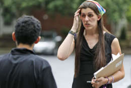 Democratic nominee for the House of Delegates 13th district seat, Danica Roem, right, talks with a resident as she greets voters at a neighborhood Wednesday, June 21, 2017, in Manassas, Va. Roem is running against Del. Bob Marshall in the 13th House of Delegates District. (AP Photo/Steve Helber)