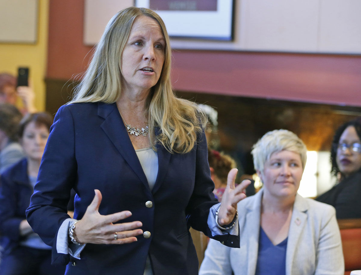 Democratic candidates for the Virginia House of Delegates, Wendy Gooditis, left, gestures as Tia Walbridge, right, listens as they speak with voters at a restaurant in Berryville, Va., Wednesday, Oct. 25, 2017. Gooditis is running for the 10th district seat and Walbridge is running in the 33rd district. (AP Photo/Steve Helber)