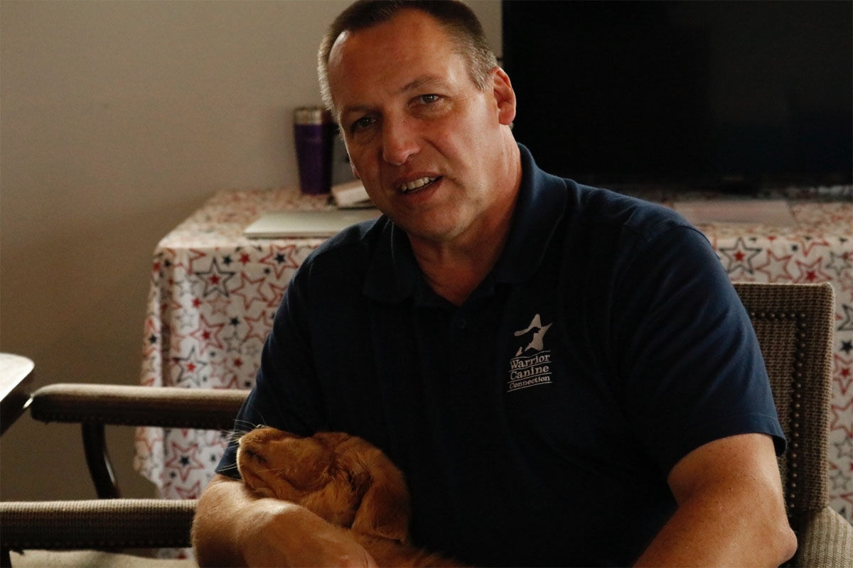 """Rick Yount and puppy """"Lou"""" after a play session. (WTOP/Kate Ryan)"""