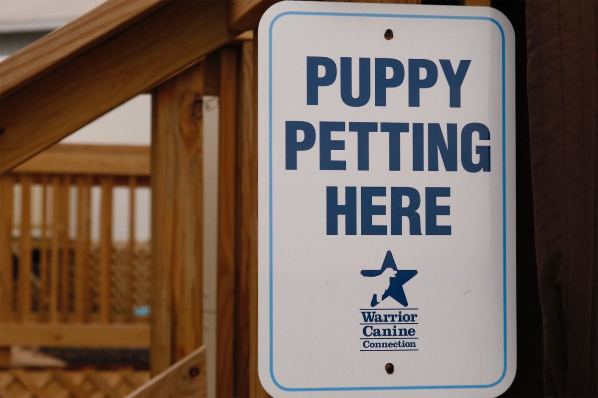 A sign at Warrior Canine Connection. (WTOP/Kate Ryan)