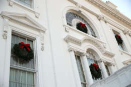 """WASHINGTON, DC - NOVEMBER 27:  Christmas wreaths are seen on the windows of the White House during a press preview of the 2017 holiday decorations November 27, 2017 in Washington, DC. The theme of the White House holiday decorations this year is """"Time-Honored Traditions.""""  (Photo by Alex Wong/Getty Images)"""