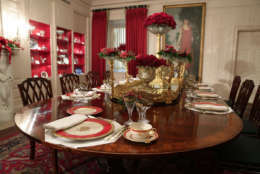 """WASHINGTON, DC - NOVEMBER 27:  Place setting are seen on a dining table in the China Room at the White House during a press preview of the 2017 holiday decorations November 27, 2017 in Washington, DC. The theme of the White House holiday decorations this year is """"Time-Honored Traditions.""""  (Photo by Alex Wong/Getty Images)"""