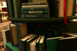 """WASHINGTON, DC - NOVEMBER 27:  Detail shot of the book volumes that form a Christmas tree in the library at the White House during a press preview of the 2017 holiday decorations November 27, 2017 in Washington, DC. The theme of the White House holiday decorations this year is """"Time-Honored Traditions.""""  (Photo by Alex Wong/Getty Images)"""